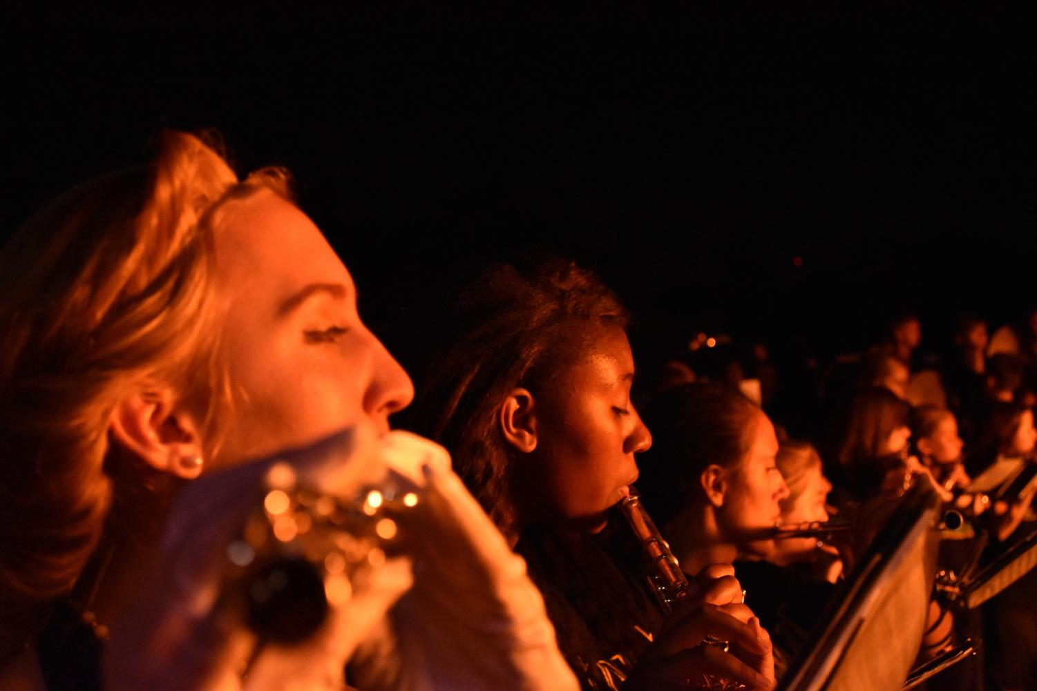 Lauren Greiner (12) and Mavis Causey (11) play flute during the Spirit of STL's performance.