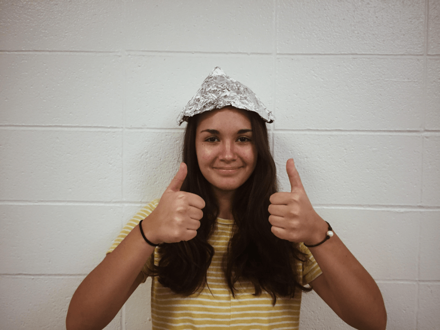 Student+Emily+Kramer+dons+this+vintage+tin+foil+hat+to+prevent+the+government+from+tracking+her+thoughts.+Kramer+has+worn+a+tin+foil+hat+since+the+day+she+was+born+which+has++put+a+stop+to+the+governments+evil+brainwashing+abilities.
