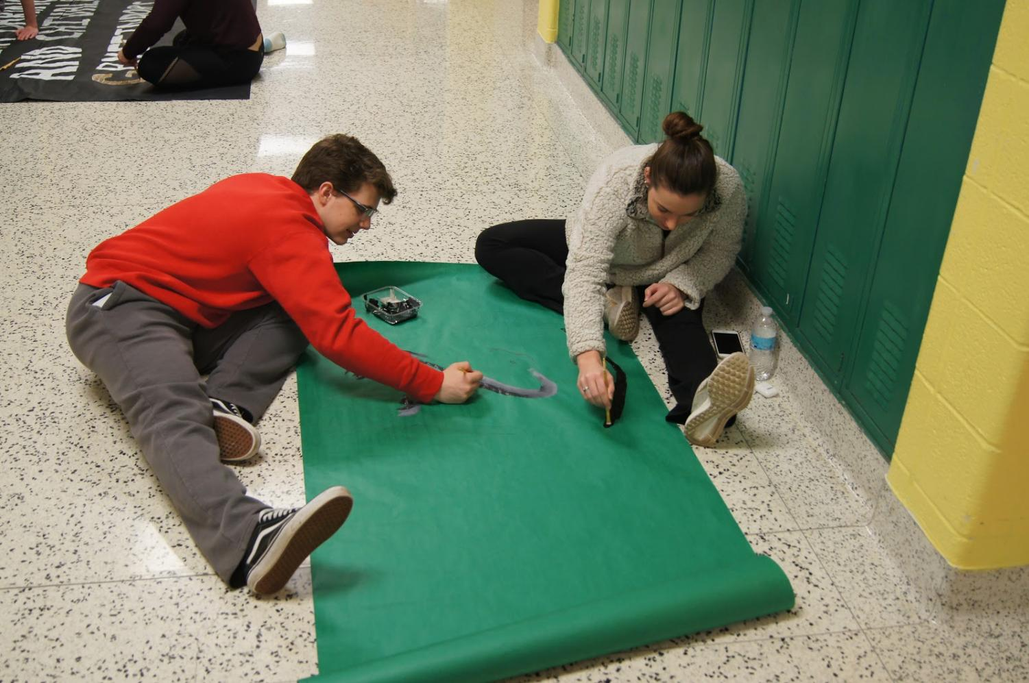 During a STUCO work day, Nick Foerstel (11) and Emily Merlo (12) work on creating extravagant decorations for Winter Formal.  The dance is slated for February 16th and features a magical Harry Potter theme.