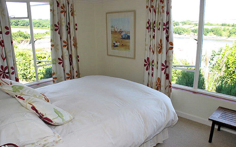 Rose on The Hill Cottage - bedroom with views across the Helford River in Cornwall