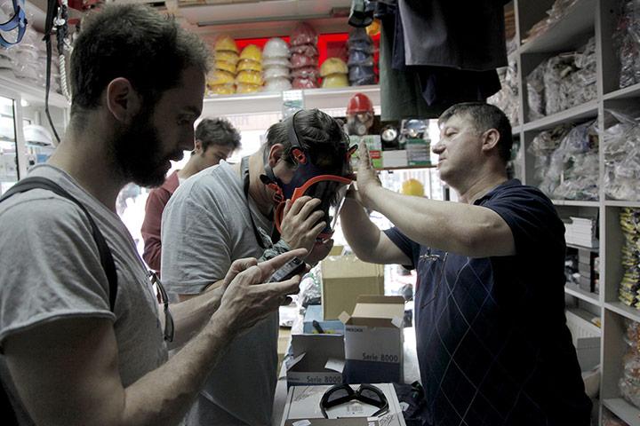 Protestors buy gas masks