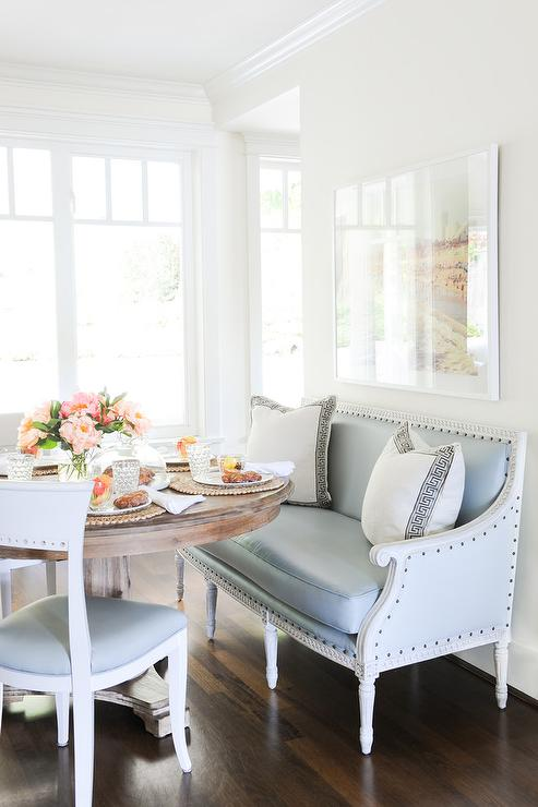 blue-french-dining-settee-round-salvaged-wood-table