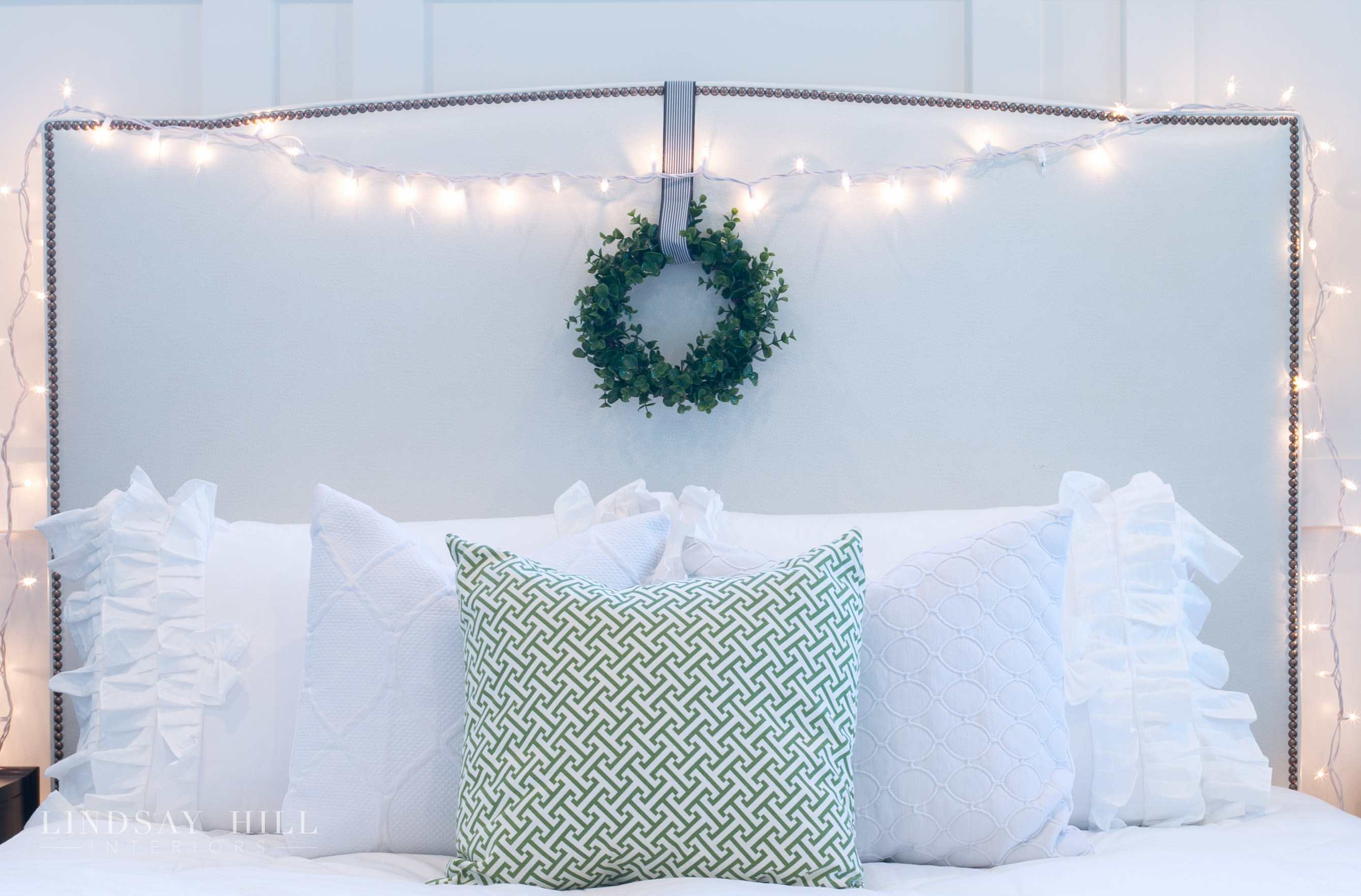 Lindsay Hill Interiors holiday home tour christmas headboard with wreath