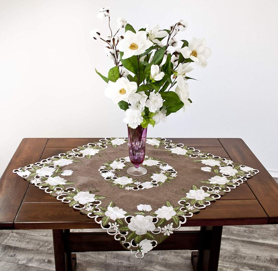 embroidered white magnolia table topper/doilies
