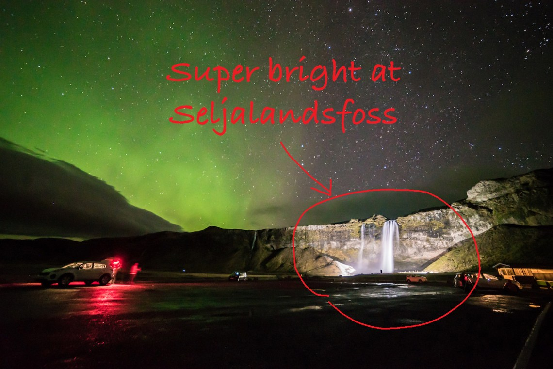 Seljalandsfoss brightly lit with flood lights. Easy for cameras to focus