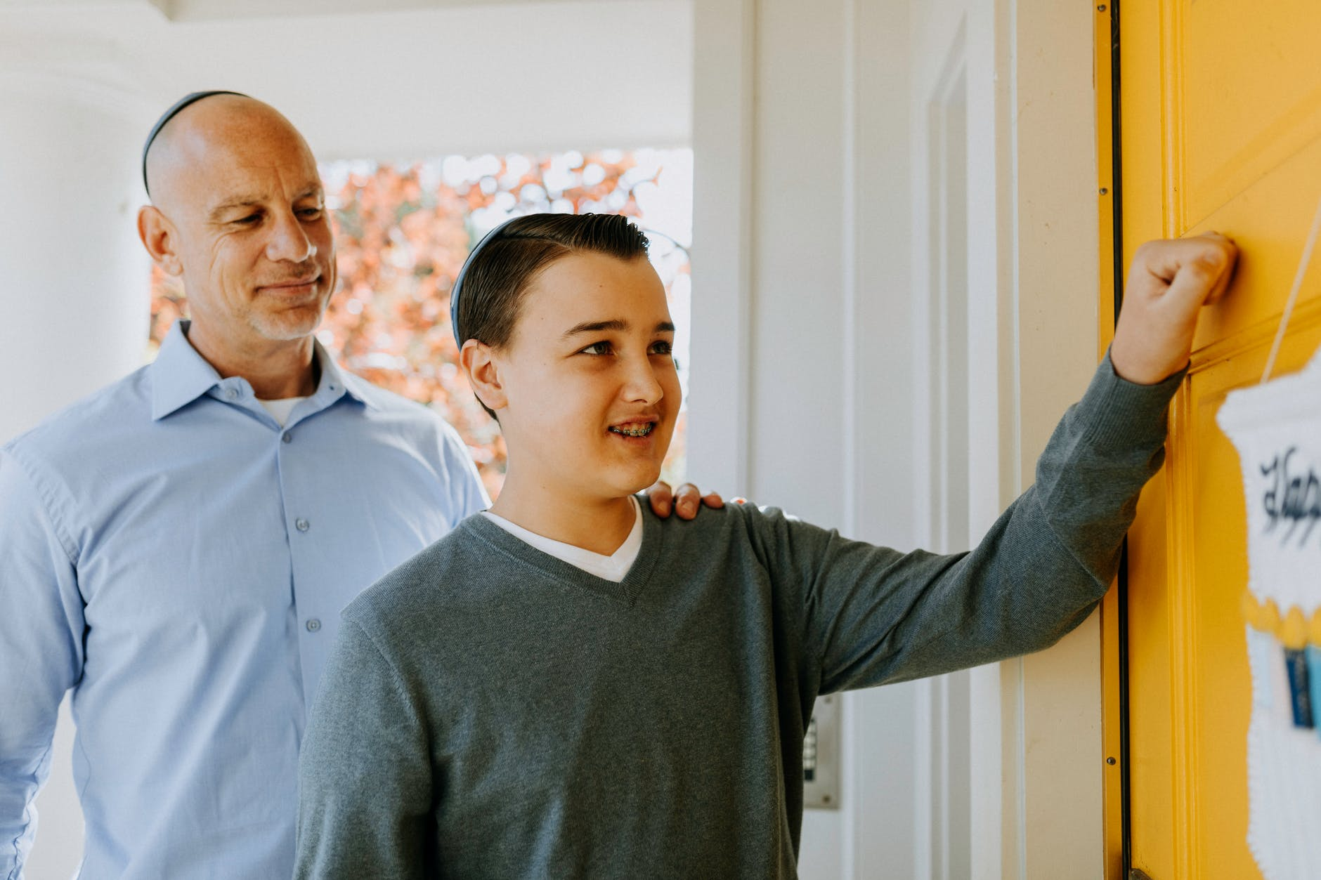 photo of boy knocking on the door