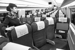 A crew is turning the seat so that the passengers seat towards the driving direction