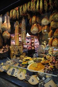 Food Market, Bologna, Italy. Picture of salami, ham and cheese in the market. The famous Mortadella of Bologna