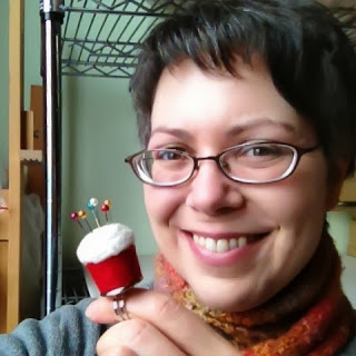 Liz Smith of Made in Lowell with one of her fiber cupcake pincushion rings