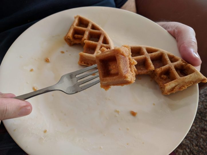 Eating a waffle square.