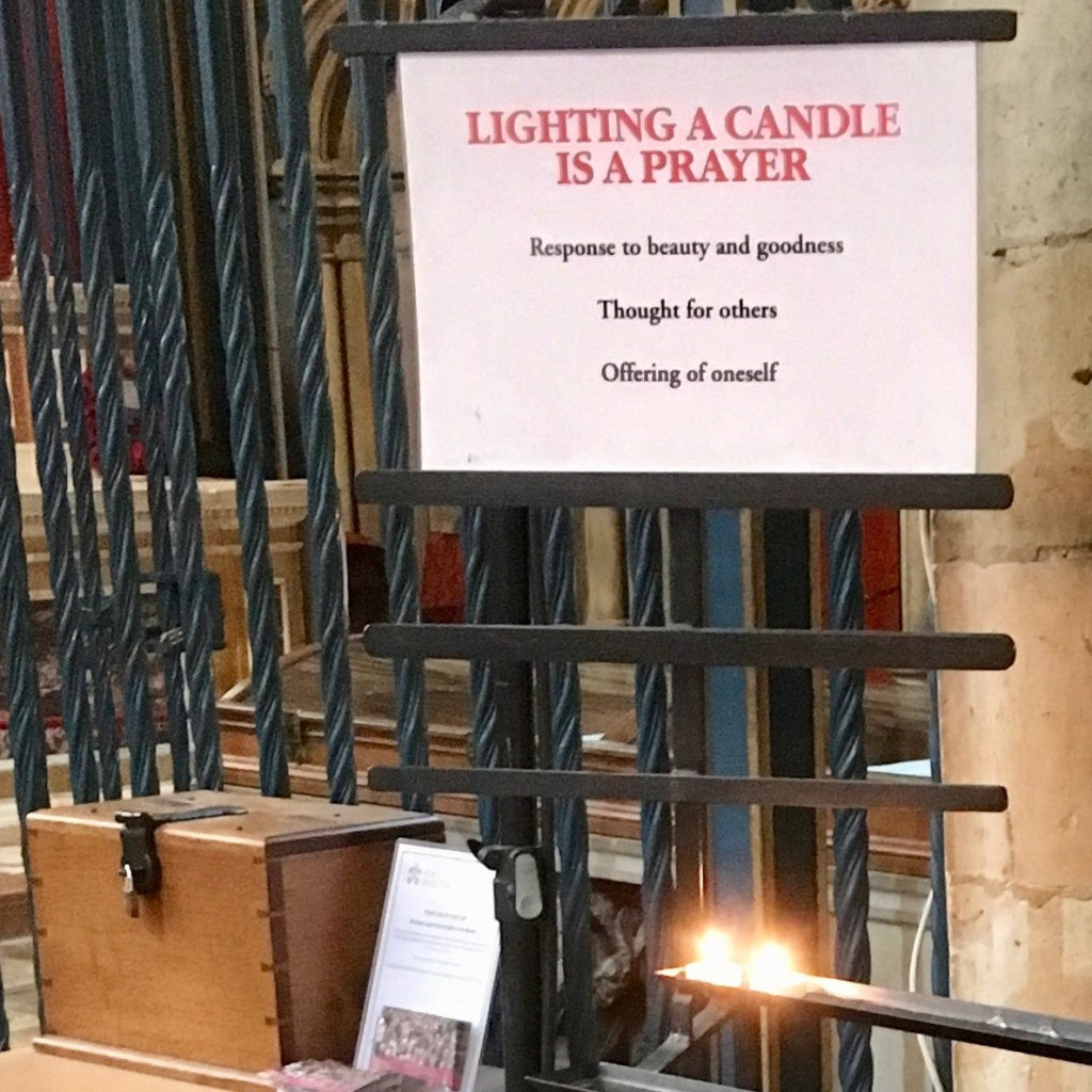 """""""Lighting a Candle Is A Prayer"""", sign in York Minster, England."""
