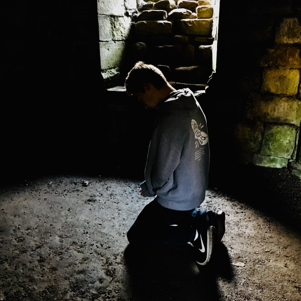 Youth praying, Finchale Priory