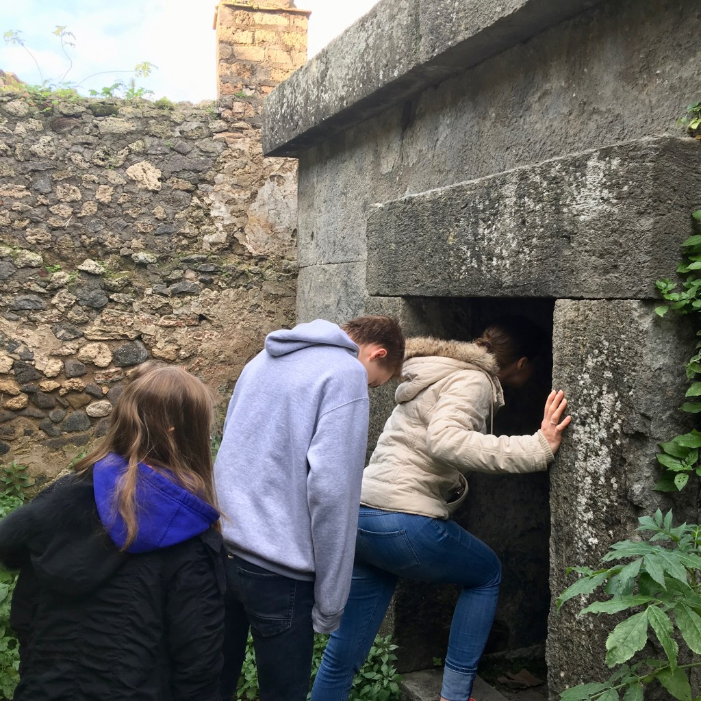 Entering a tomb in Pompeii