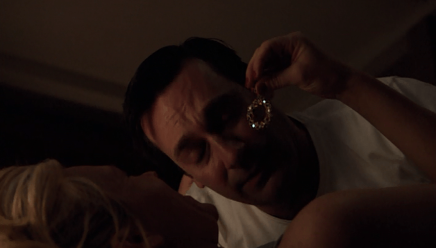 Tricia finds the earring under Don's bed