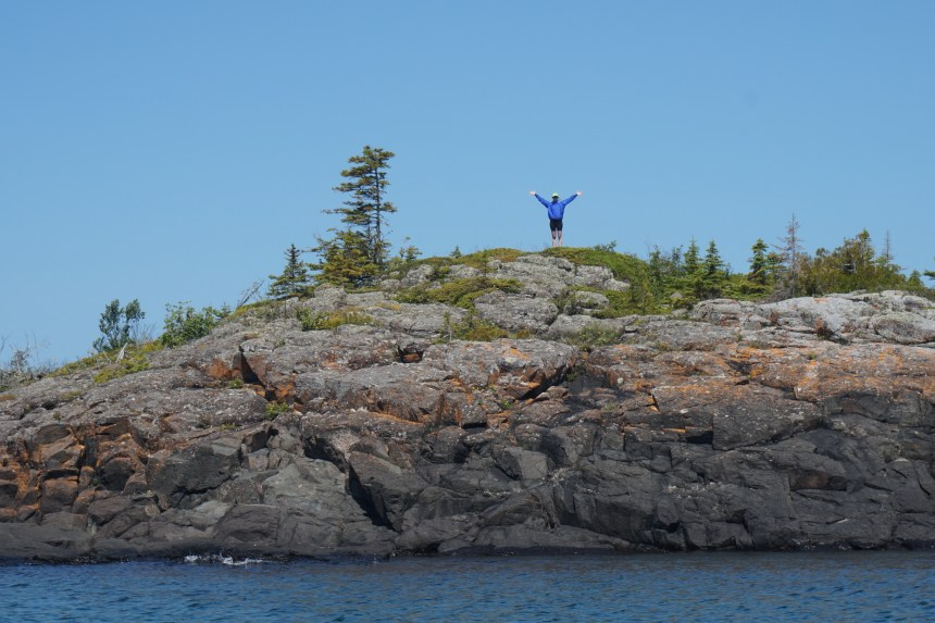 Jacey celebrates making it to the top of one of the tiny islands.