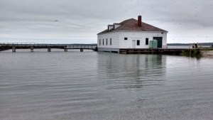 The exterior of the 1939 boathouse has been recently restored and work was performed on the 200-foot pier so supplies and materials can be landed at the station safely.