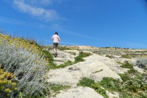 Mary climbs limestone steps as we depart Dwejra Bay.
