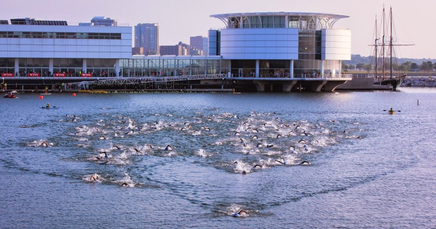 I borrowed this image from last year's race to show what the start of a wave looks like as athletes swim from the Discovery World pier and swim south toward the footbridge at Lakeshore State Park on Milwaukee's lakefront.