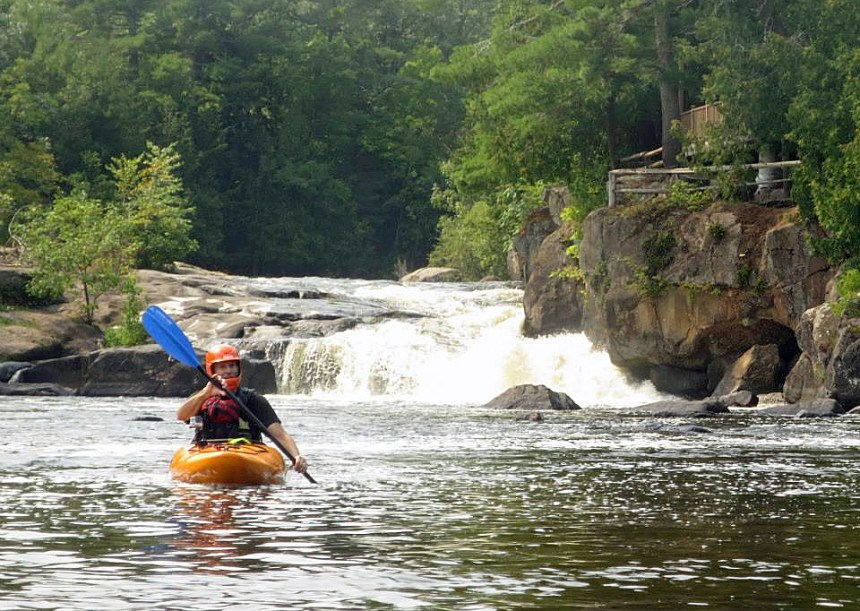 It may be hard to tell because of the helmet but I'm all smiles after successfully paddling Big Smokey Falls. Photo by Mike Brown.