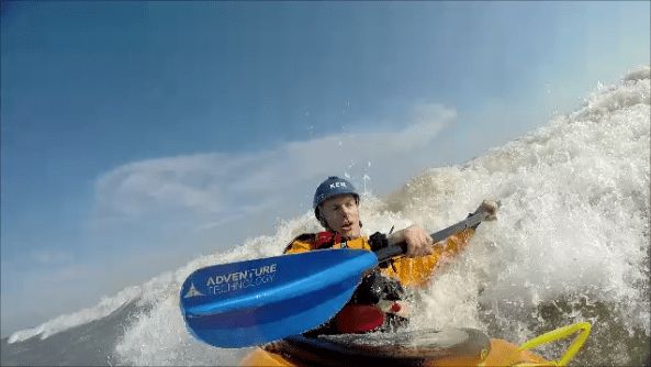 Kayak surfing Lake Michigan