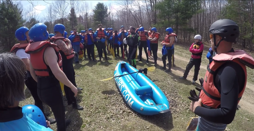 Dale Guarniere gives a safety briefing to the funyak paddlers.