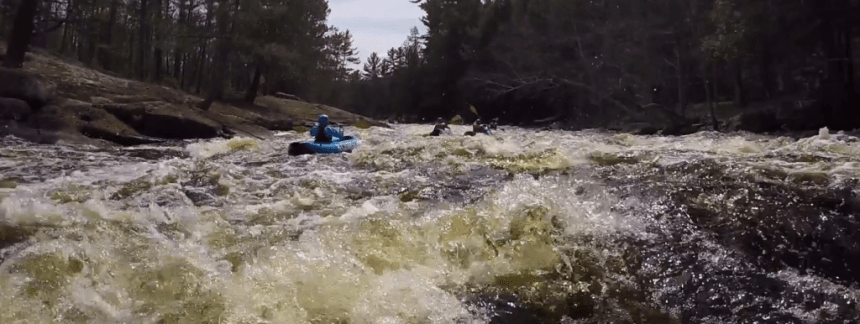 Mary rides the rapids of the Peshtigo River.