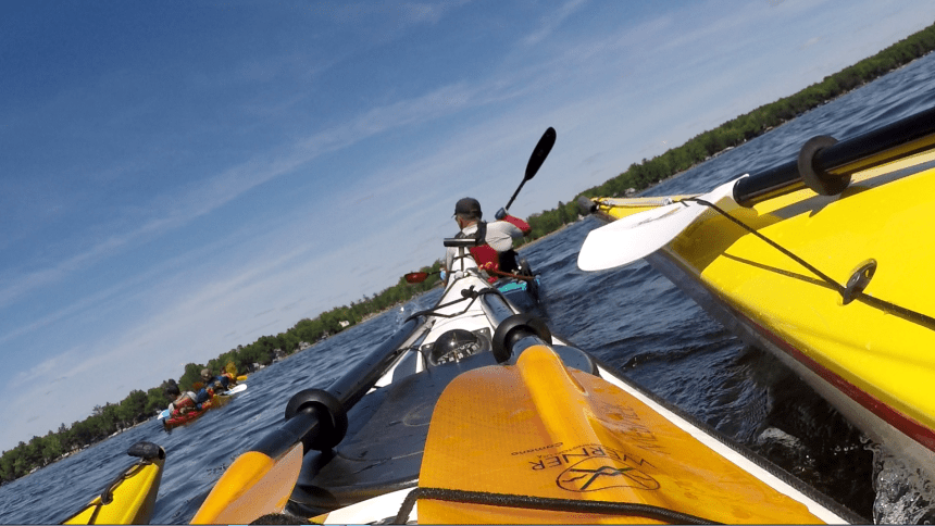 Here's the view from my cockpit as I am supported by a kayaker on each side and the three of us are towed to shore by two other kayakers performing an in-line tow. To the left, Bill is towed by another student.