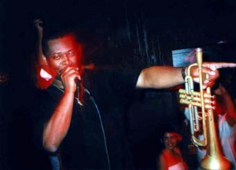 """""""Sweat 'til you bleed!"""" Ron making a rare rap performance at the Double Door, Labor Day weekend, 1999."""