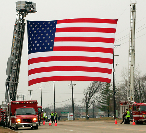U.S. flag flies across five lanes of traffic