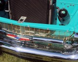 1957 Chevy Bel Air gold trip with red, white, and blue Chevrolet name plate