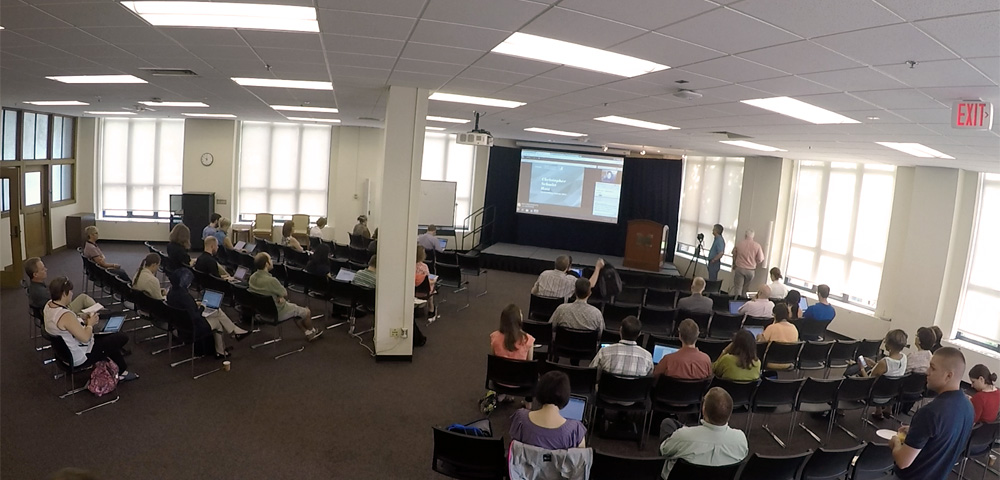 Attendees seated in Gallery at University of Michigan Grad Library