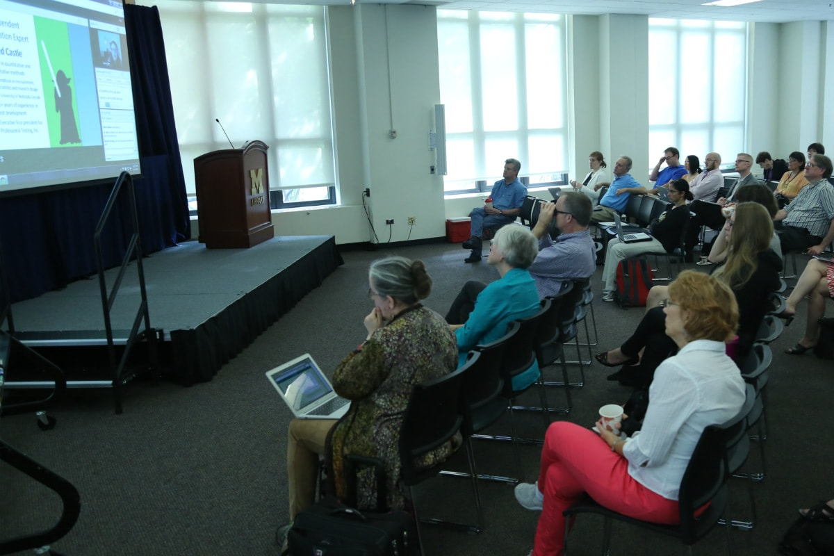 2015 Accessibility Summit attendees at University of Michigan Graduate Library watching presentation