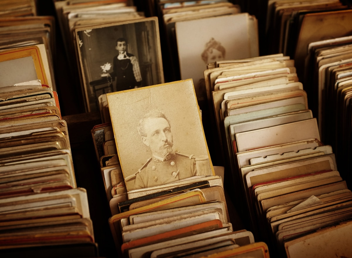 antique black-and-white photos stored in a box