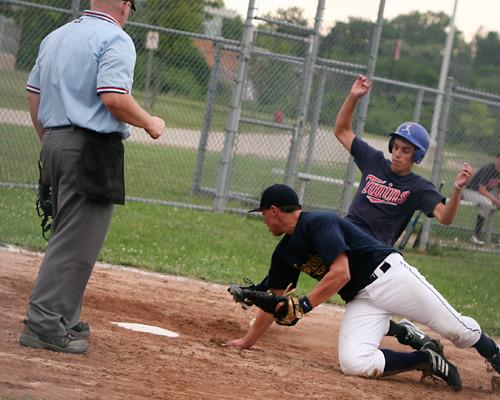 baseball game: player sliding into base