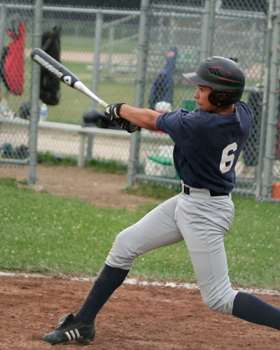 Baseball player at bat swing and a hit