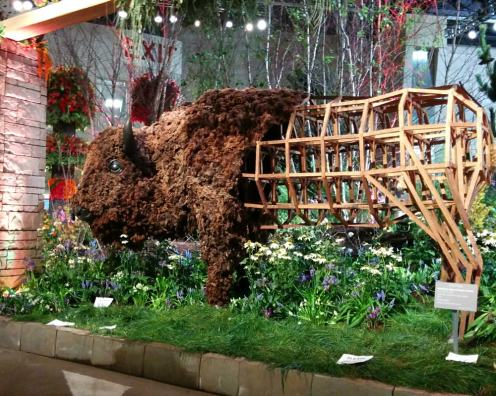 Bison sculpture created from mulch and other materials