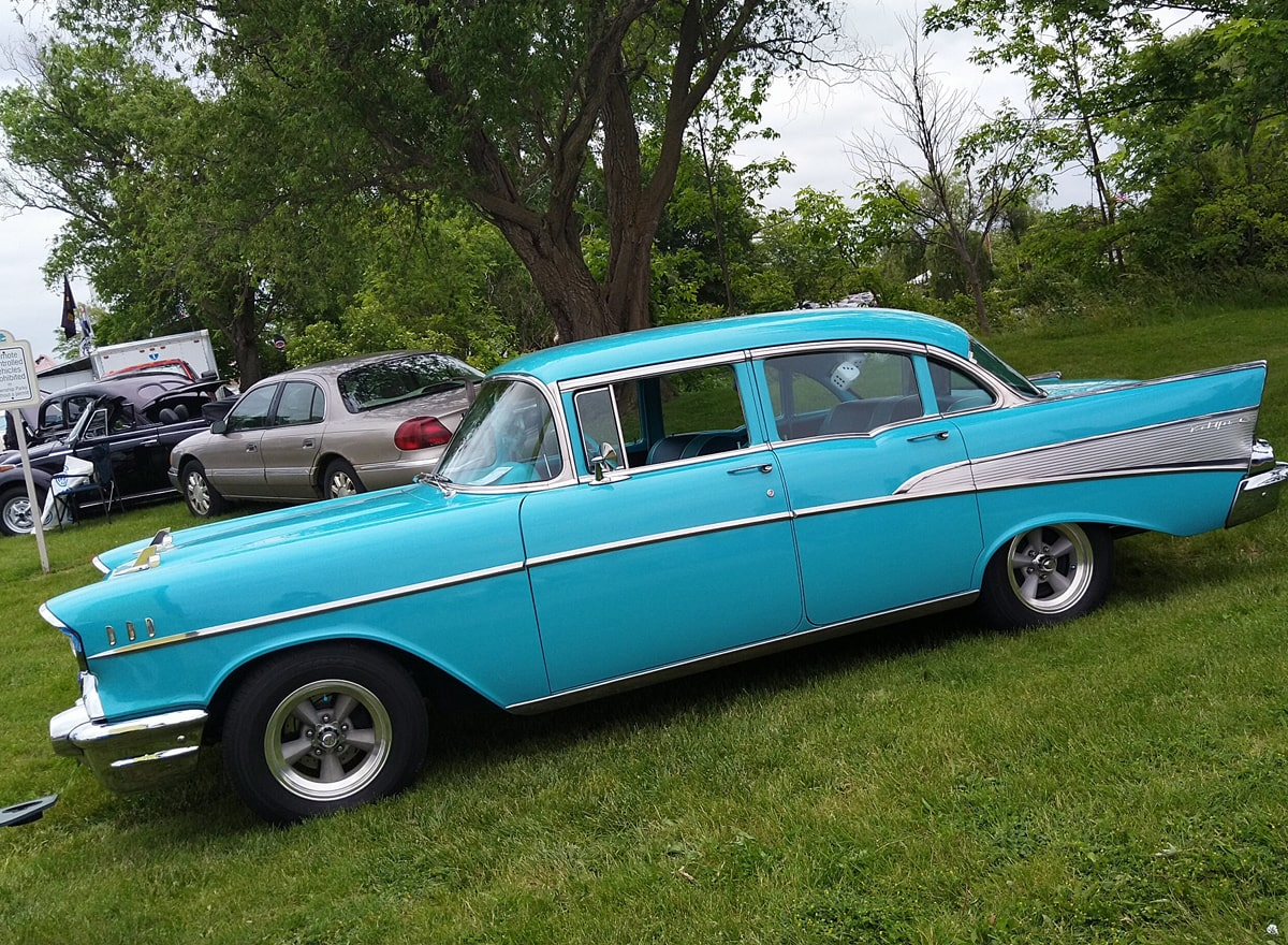 blue four-door Chevy Bel Air with chrome trim.