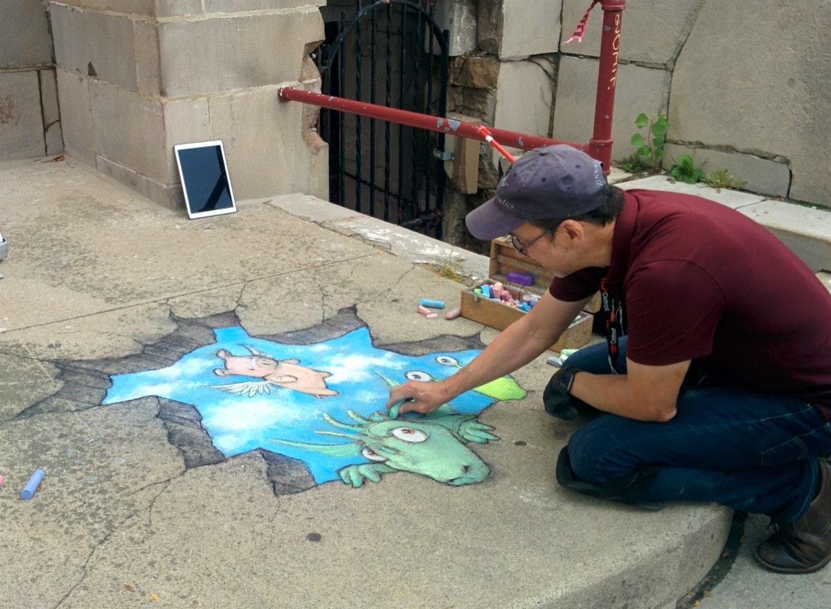 David Zinn uses his colored chalk to create sidewalk art