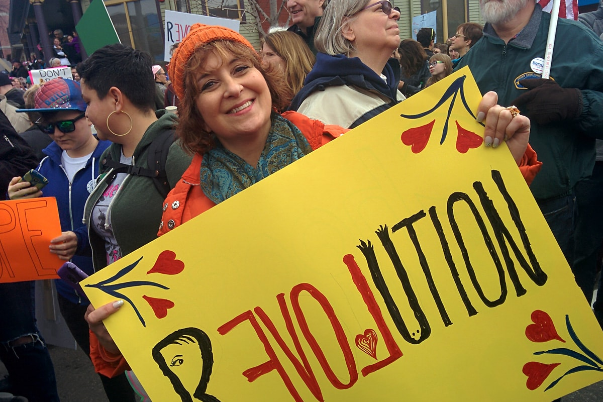 Deb Nystrom showing her great Revolution sign for the march