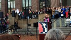 Rep Debbie Dingell on the steps of the UM Graduate Library encourages marchers to get involved
