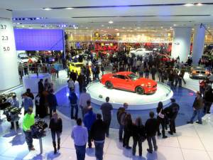 View of the crowd and red Mustang at the North American International Auto show
