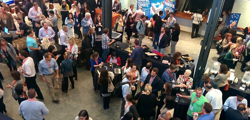 attendees gathered at Digital Summit Detroit sponsor area.