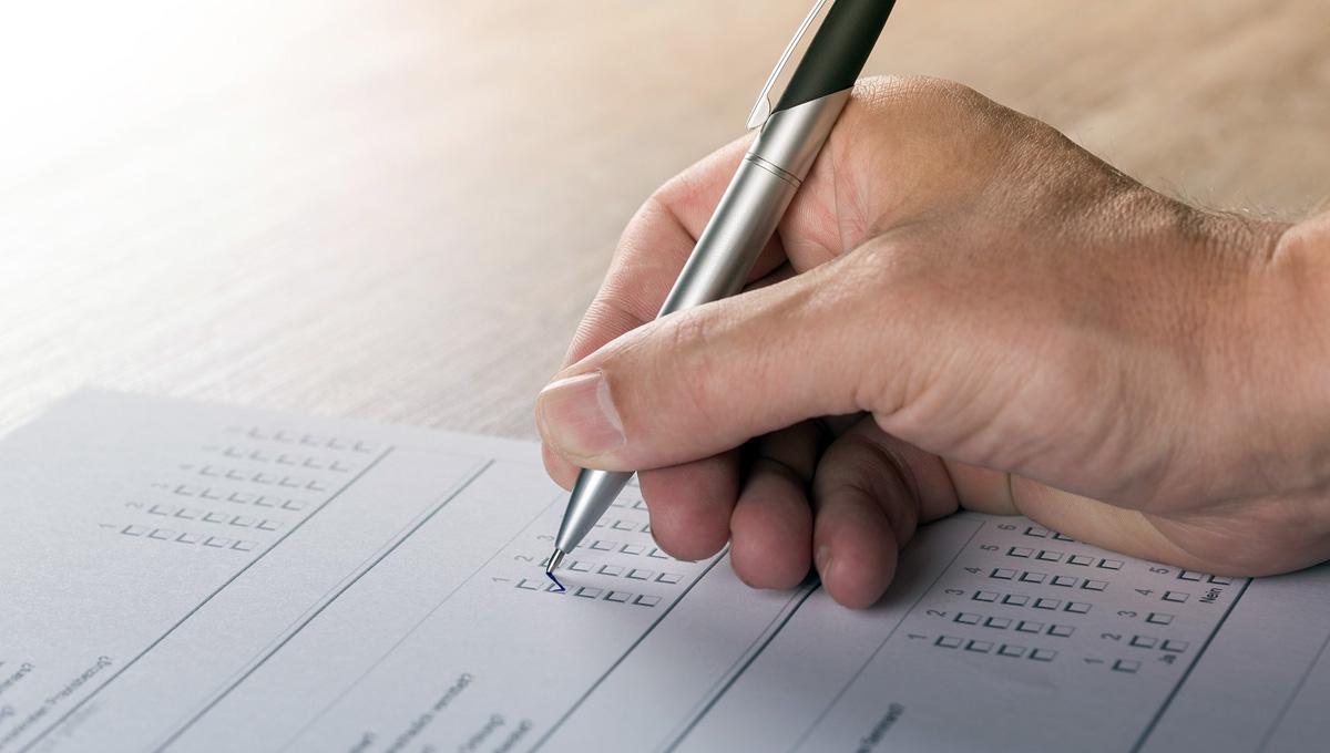 filling out a paper survey