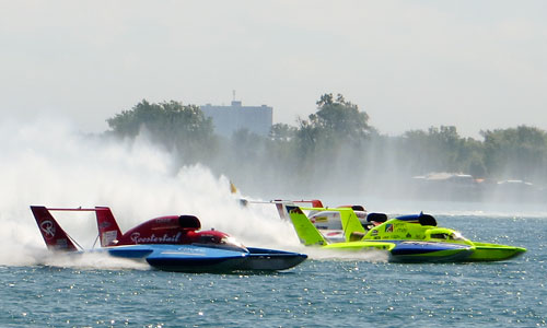 Two hydroplanes race on the Detroit River during the 2013 Gold Cup races