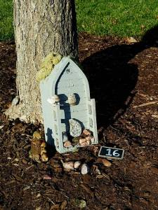 Petoskey stones and driftwood adorn the fairy door of the Great Lakes.