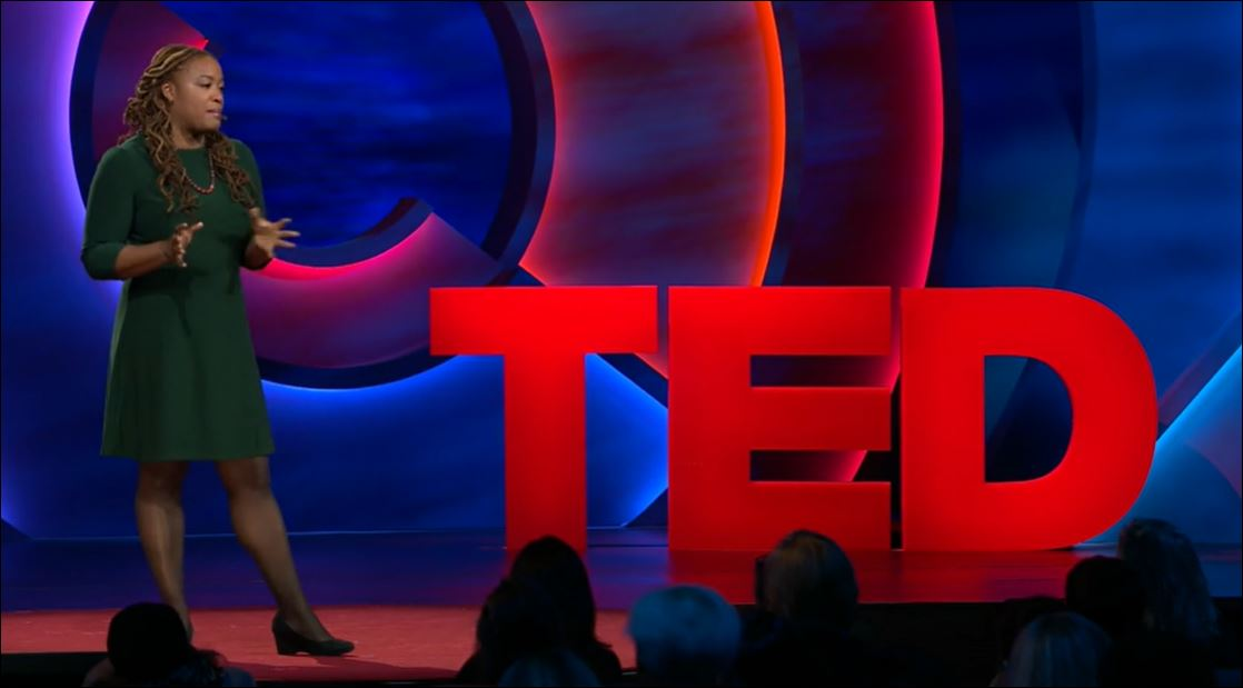 Heather McGhee speaking from the stage of TED Women 2019.