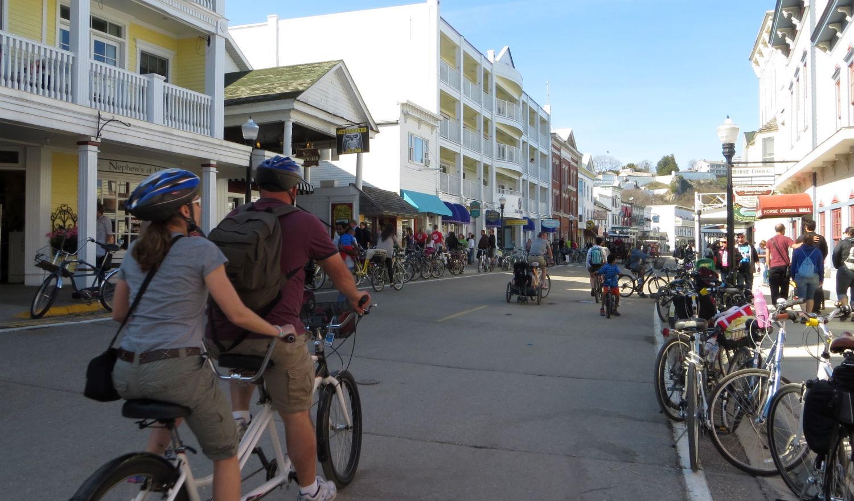bicycling down Main Street on Mackinac Island, Michigan