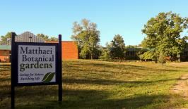 Sign for the Matthaei Botanical Gardens, research building in the background