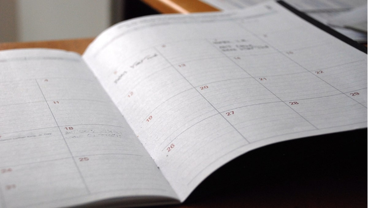 open paper monthly calendar planner with days organized in rows and columns.