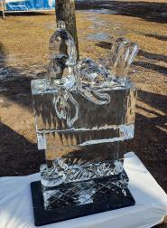 Snoopy lays on top of his dog house ice sculpture.
